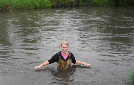 Becca monitoring water in the Little Sioux River while attending a 4 week ecology course at Iowa Lakeside Lab.