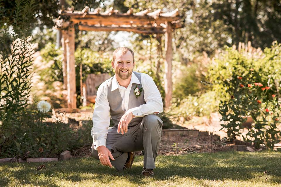 groom in garden.jpg