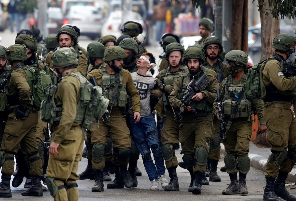 During protests against President Trump's announcement on Jerusalem, 16-year-old Fawzi al-Junaidi is arrested by 22 Israeli soldiers and charged with rock throwing.
