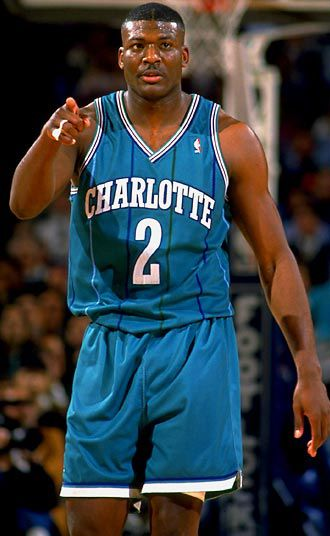 Larry Johnson wearing the teal kit that would soon make the Charlotte Hornets famous, not for their athletic performances but instead for their visual appeal. Source: http://thehoopdoctors.com/2013/11/next-years-hornets-will-go-back-to-vintage-purple-and-teal/