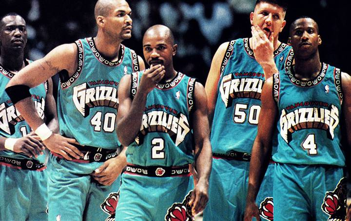 Members of the Vancouver Grizzlies took the court in 1996 in perhaps one of the busiest uniform designs of the era (special attention on the collar and arm patterns based upon the pacific northwestern Native American designs