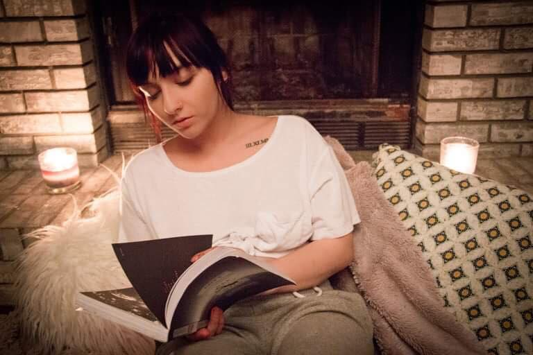 Winter is cozy with Ames reading a book. Photograph by Inferno Imagery