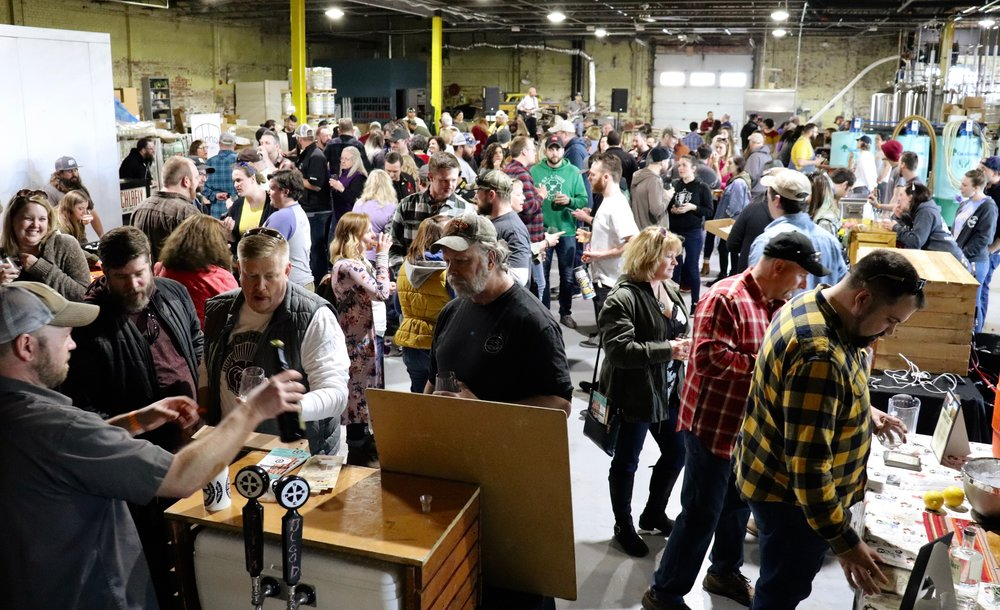 The crowd gathers in the brewery for fun and support of pollinators. Photo by Rosita