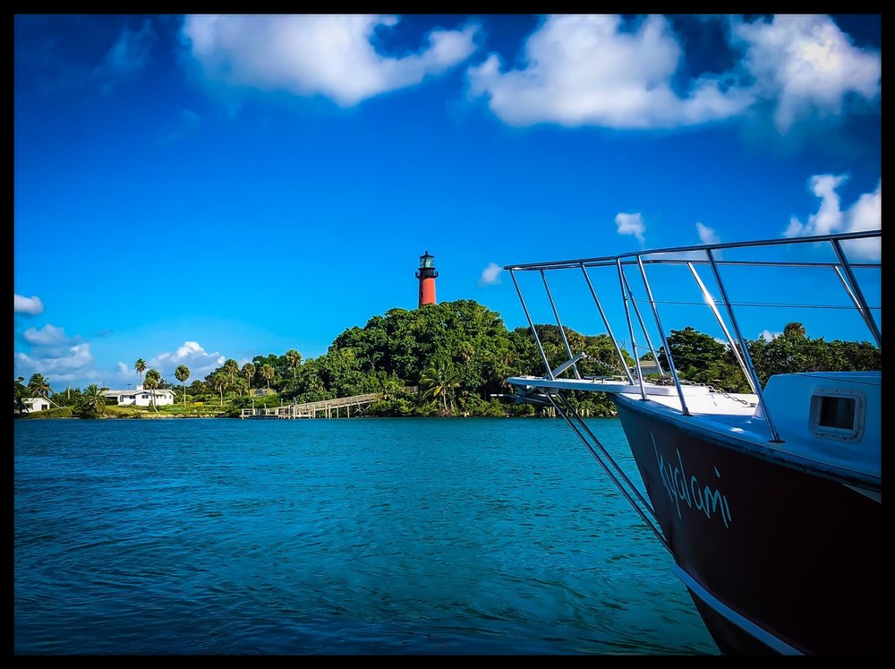 Boat and Lighthouse.JPEG