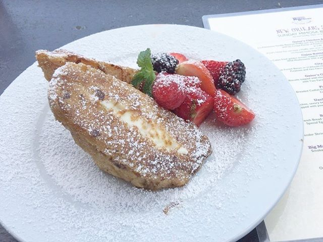 SUNDAY BRUNCH 10-2: Bourbon Street Stuffed French Toast - Sweet French Bread stuffed with Orange Marmalade and Cream Cheese, dipped in Gator's Special Egg Batter and, served with Fresh Berries and Powdered Sugar. #repost from Abe L. on Yelp! #gatorscreolefriends