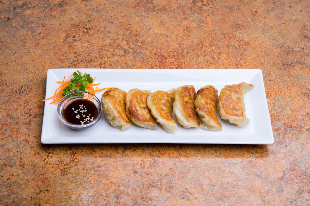 Vegan friendly pot stickers. Order today at Loma House Vegetarian Express a vegetarian restaurant in south Edmonton.