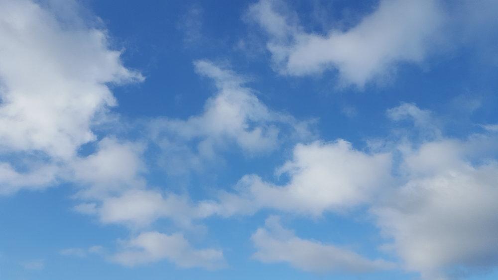 blue sky puffy clouds.jpg