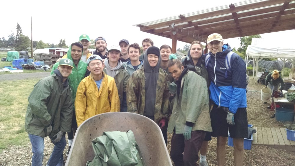 New Sigma Nu fraternity volunteers ready for a day in the rain.