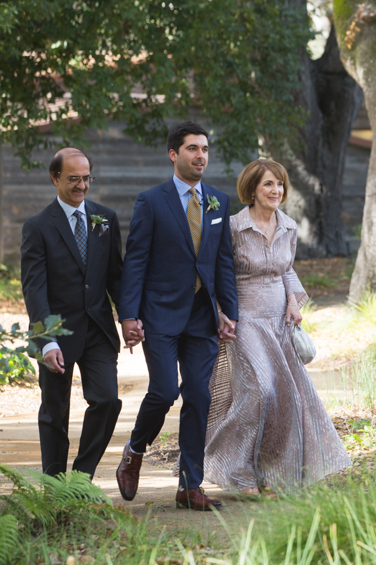 carmelweddingprocession_groomwithparents_gardenerranchwedding.jpg