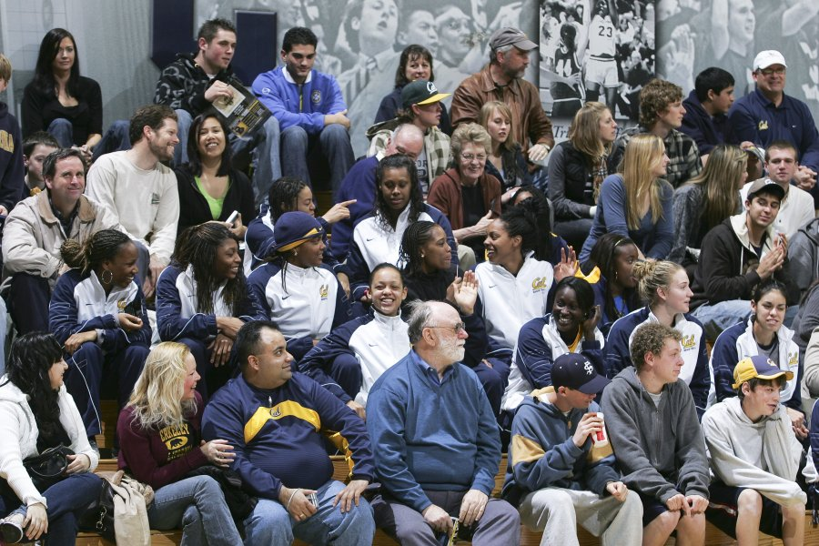 Members of the CAL Women's Basketball Team (amongst other fans) watch the game