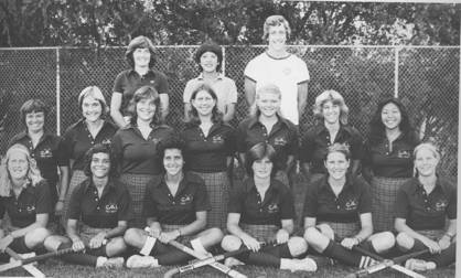 Cal's 1980 Field Hockey Team  –  Headed to the National Championships . . . or posing for a Toothpaste Ad?    Front Row  l-r: Emily Schwegman, Kim Hunter, Marcy Place, Kathy Webb, Sandi Chamberlain, Shellie Ohstead;  2nd Row : Terri Bonwell, Ester Dahl, Maureen Robbins, Melissa Nerone, Corinne Hanson, Renee Chatas, Jeanette Mori;  Back Row : Clair Nicholson (Ass't Coach), Donna Fong (Head Coach), Tom Shaer (Ass't Coach).