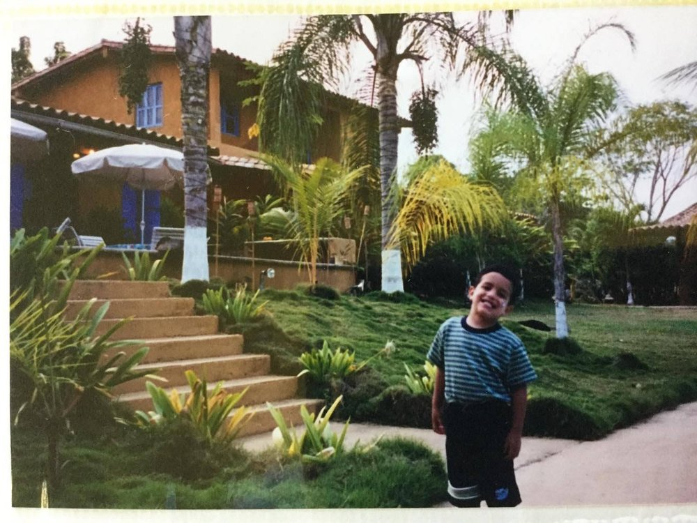 Belardi at the steps of his childhood home in Venezuela.    Photo courtesy of Belardi.