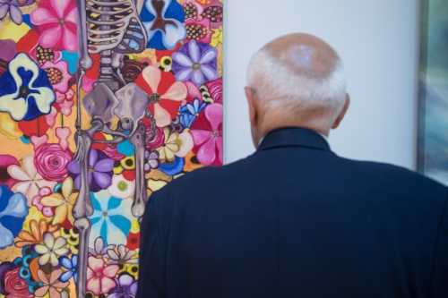 A guest considers artwork at the Bombay Sapphire Artisan Series finale