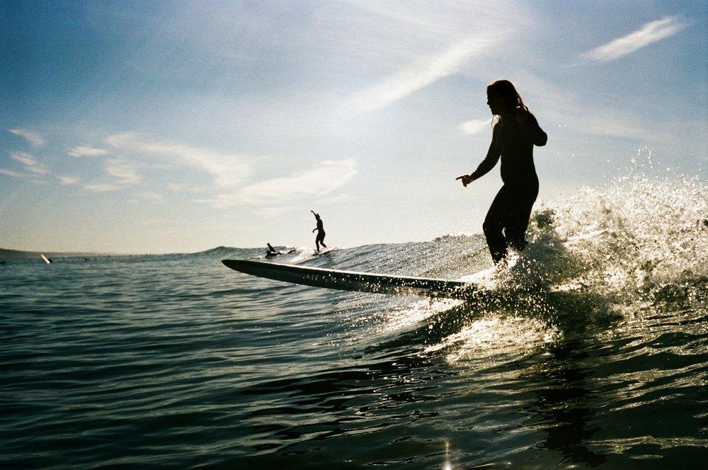 She surfs. (Orange County, California)