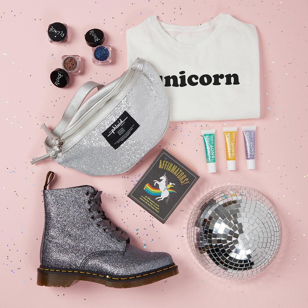 UNICORN - Unicorn Snot Lip Gloss - $10Dr. Marten's 1460 Pascal Glitter - $120Fluide Glitter - $15