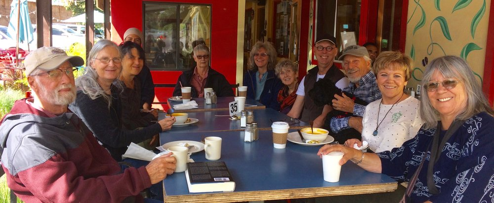 The community enjoying coffee together after Sunday morning meditation practice. Photo by Larry Milam.