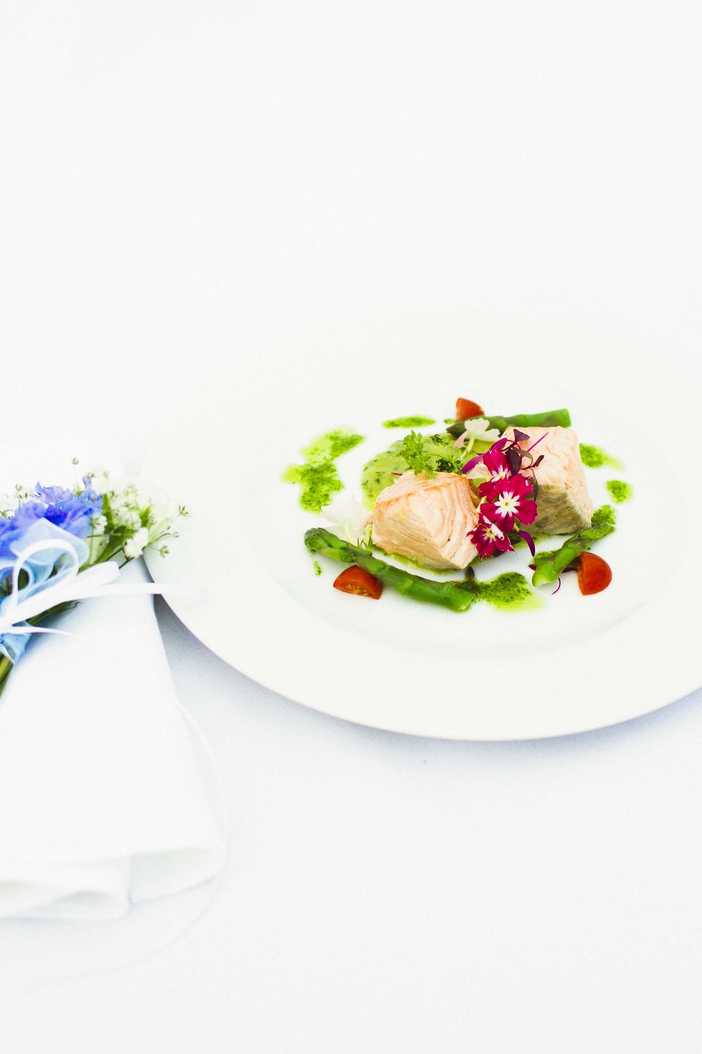 Catering inspiration - poached salmon with minted asparagus veloute and edible flowers