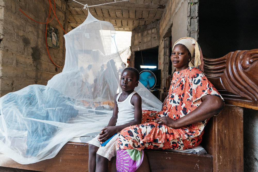 woman and boy with mosquito net senegal