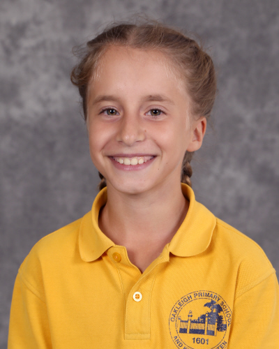 My name is Alice. I am 11 years old. I live in a family of 6 with a twin sister, Leila, and my two older sisters Emma and Sally, and a dog named Cookie. My hobbies include sport and art. I am a Vice Captain at Oakleigh Primary School. I applied to be a Captain because it can help me with public speaking and I like to help others if they struggle. By the end of the year I hope to become more confident.
