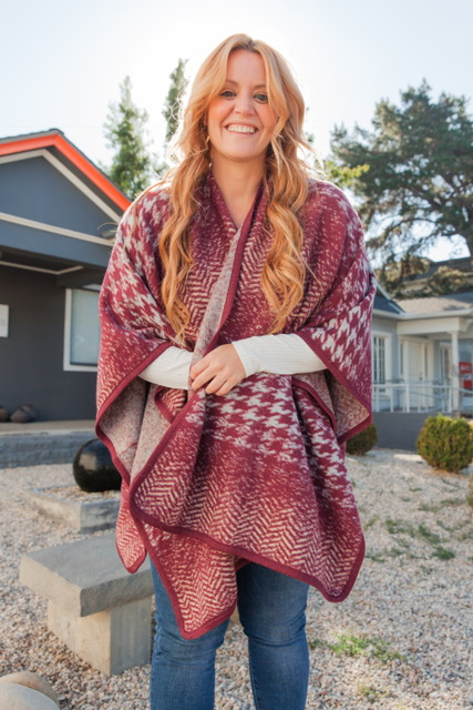Falling in love with this Red Ruana from The Lulla Collection!    Price: $30 (The Lulla Collection)
