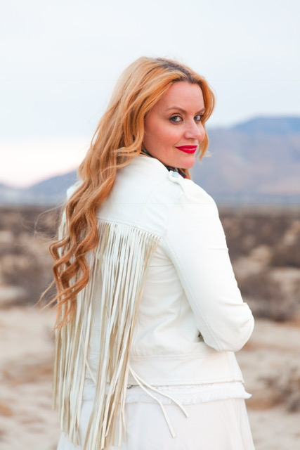 Tassles for days in my cute white jacket from  Jacket: