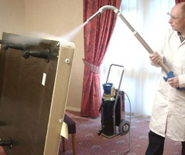 Applying Cryonite, poison-free solution for Bed Bug Freezing in Suffolk County, NY.