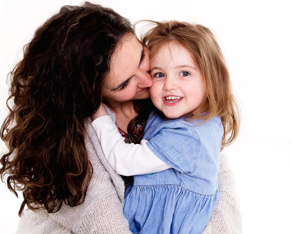mum daughter cuddles