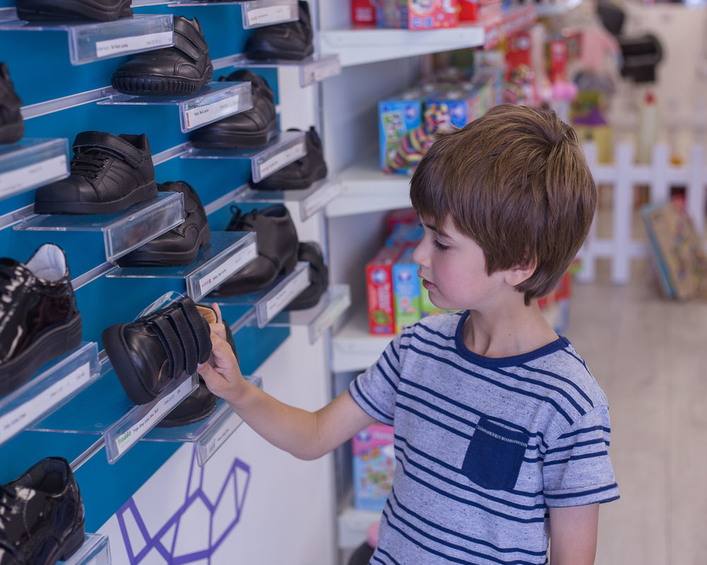 child shopping for school shoes