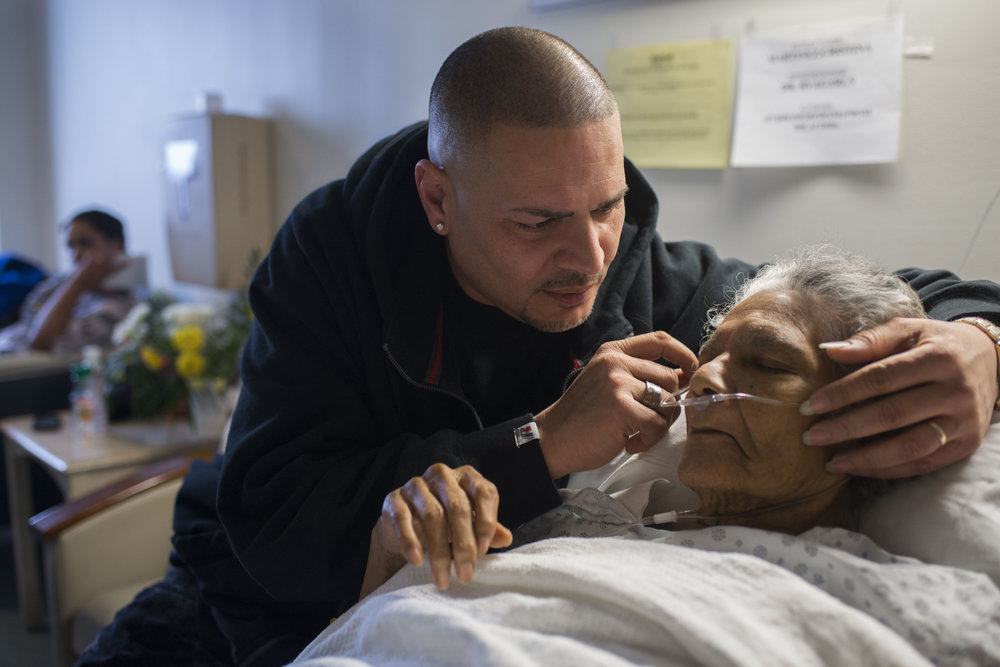 Green Eyes comforts his dying grandmother in hospice care, having been granted a month long sentencing delay to pay his respects and say goodbye. He travels to Brooklyn three times—twice to visit her at Wyckoff hospital and once more for her funeral.