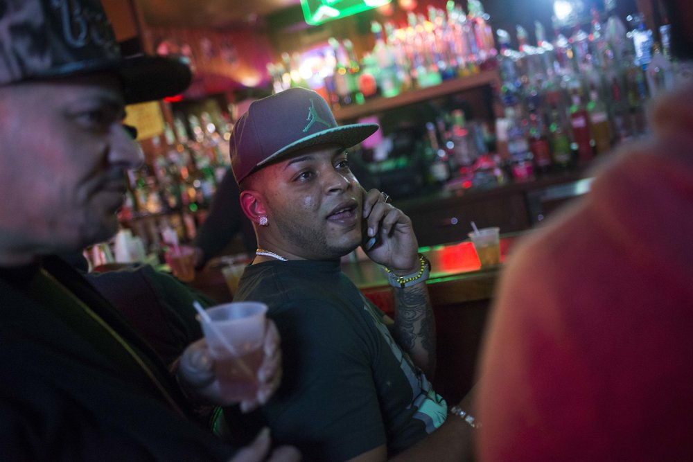 Green Eyes and Bebo spend Fridays playing pool at Calcano's Tavern before his sentencing. On a busy night, cars pull up on the sidewalk to park, avoiding the recesses of the side streets where auto burglaries are likely.