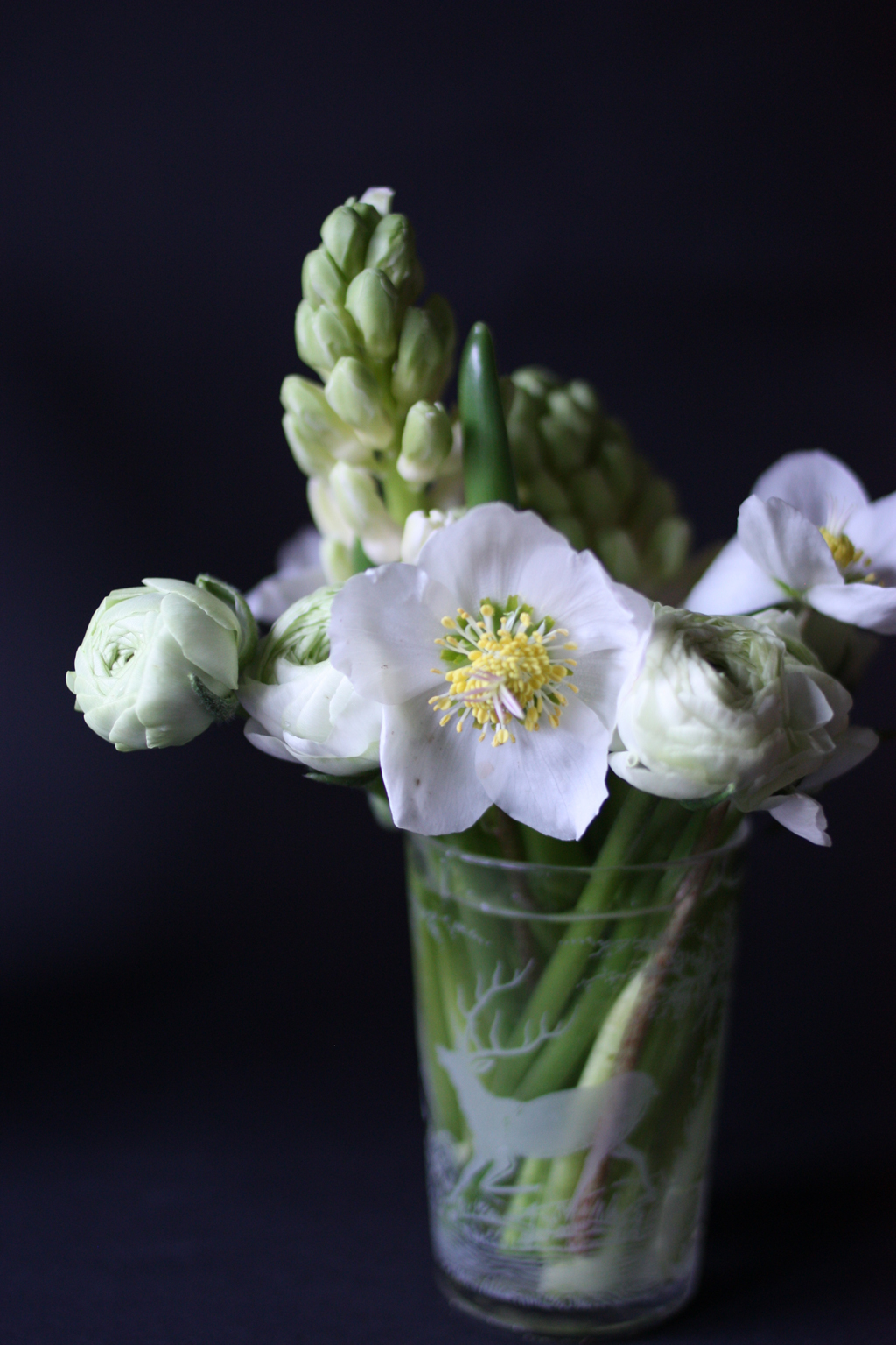 small white bouquet in a transparent vase