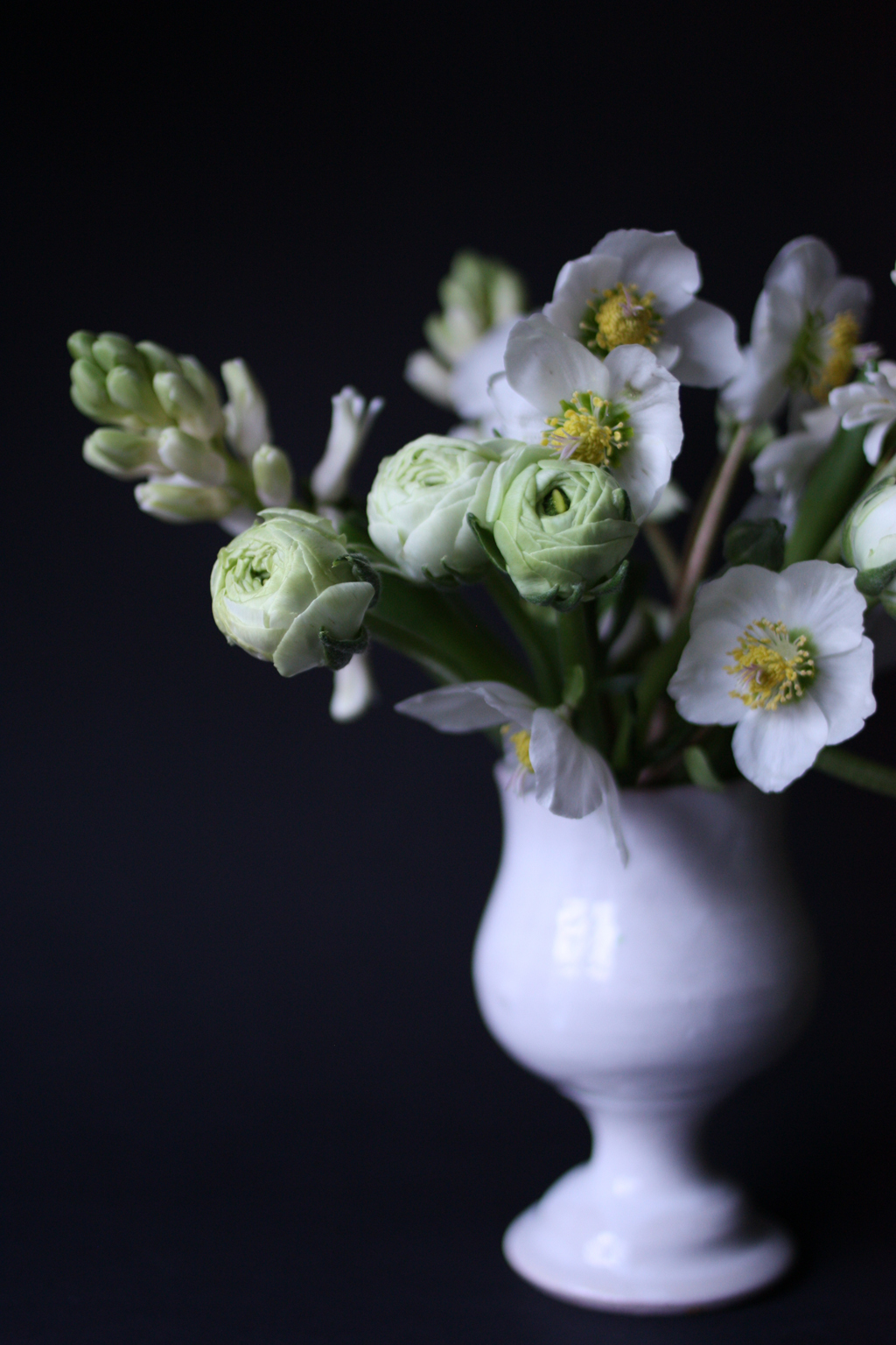 white bouquet in a white vase by madame love