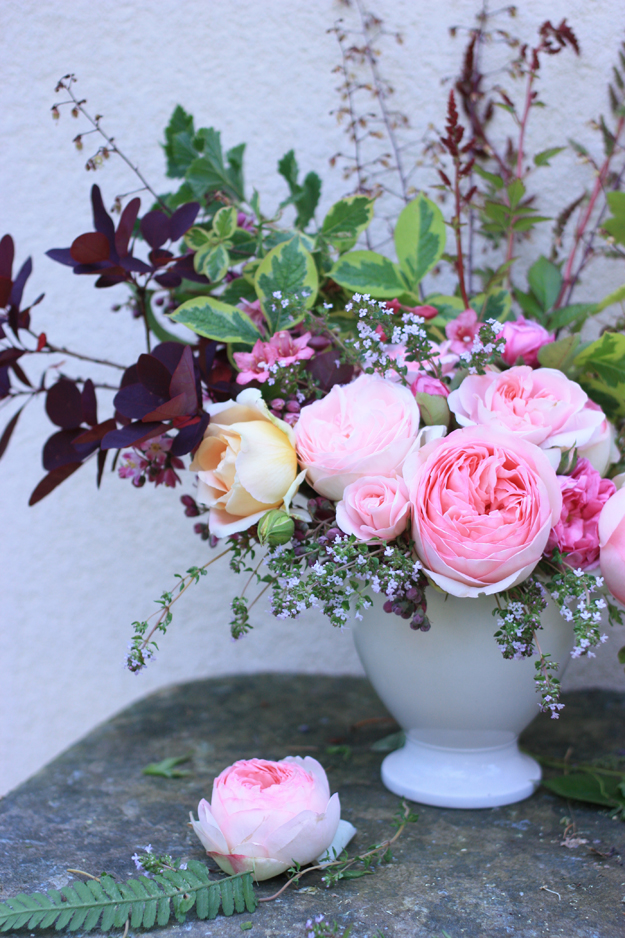 pink garden roses in a white vase