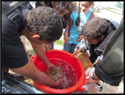 Hatchery technician shares flounder project with Tribal youth