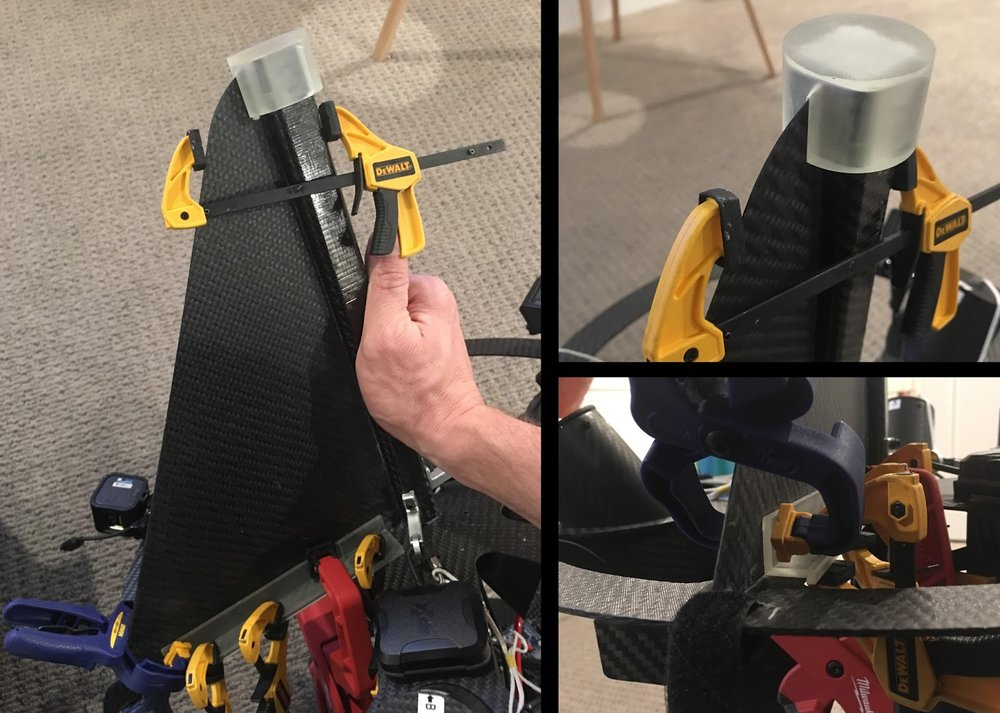 3D-printed jigs held in place with clamps; very useful for alignment when bonding carbon fiber pieces with epoxy