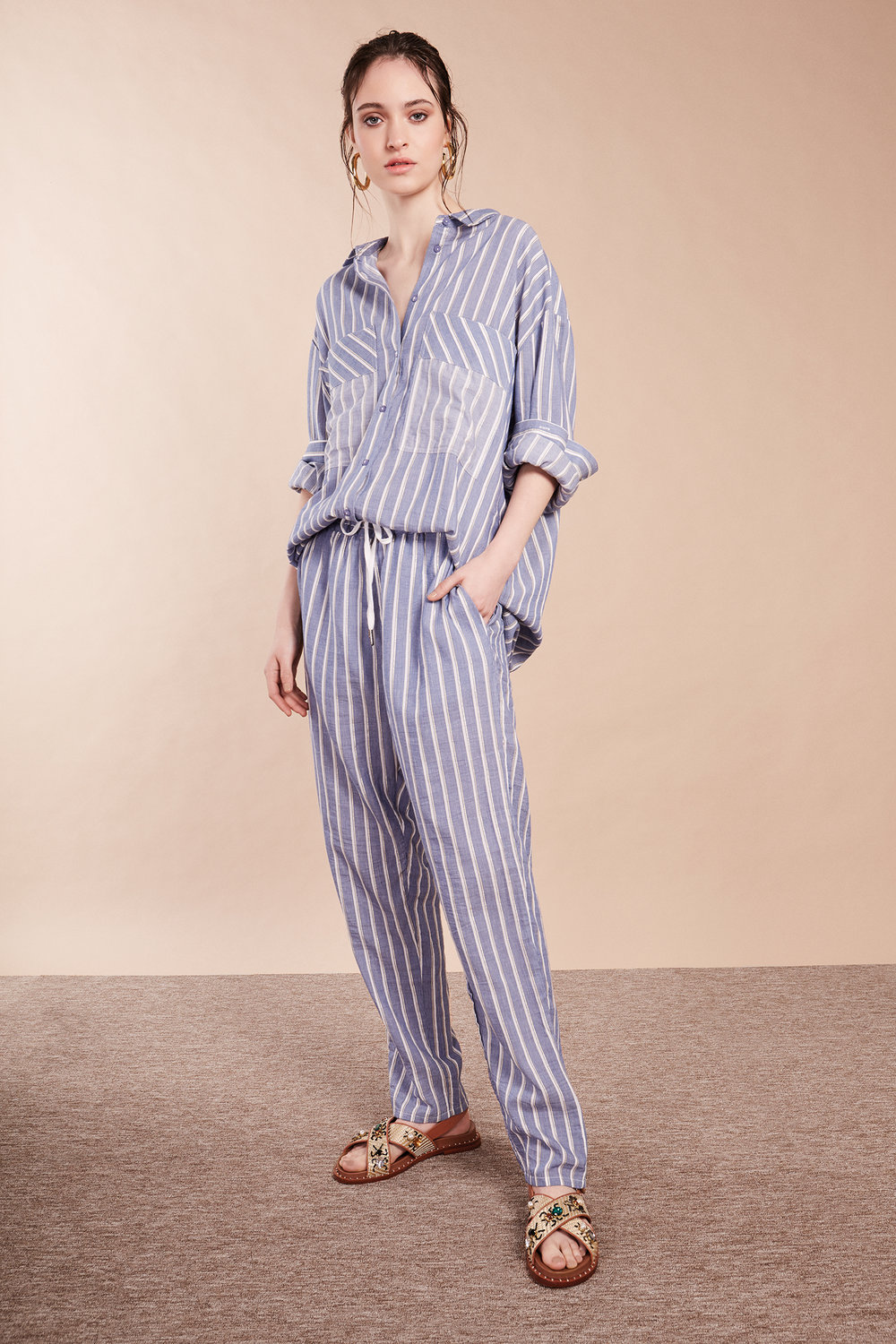 7 - Laura Lombardi earrings (as before); Munthe striped shirt, £179, Grace and Mabel; Munthe striped trousers, £139, Grace and Mabel; Ash sandals, £185, Grace and Mabel