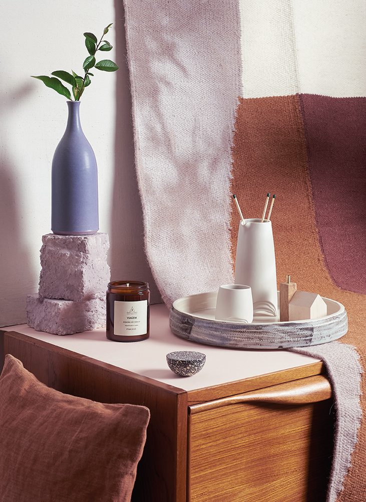 Retro revival - Linen cushion by Margarete Häusler, £69, Maze.Lavender vase by Lucy Burley, £44, Seed.Viagem candle by Earl of East London, £20, Resident Store.Cast iron hook by Ferm Living, £17, Resident Store.Sake set by Eradu Ceramics, £68, Verve Living.Mini wooden shed by Temper Studio, £20, Kobi & Teal.Ceramic dish by Michelle Freemantle, £50.60, Seed.Rug by Ferm Living, £99, Resident Store.