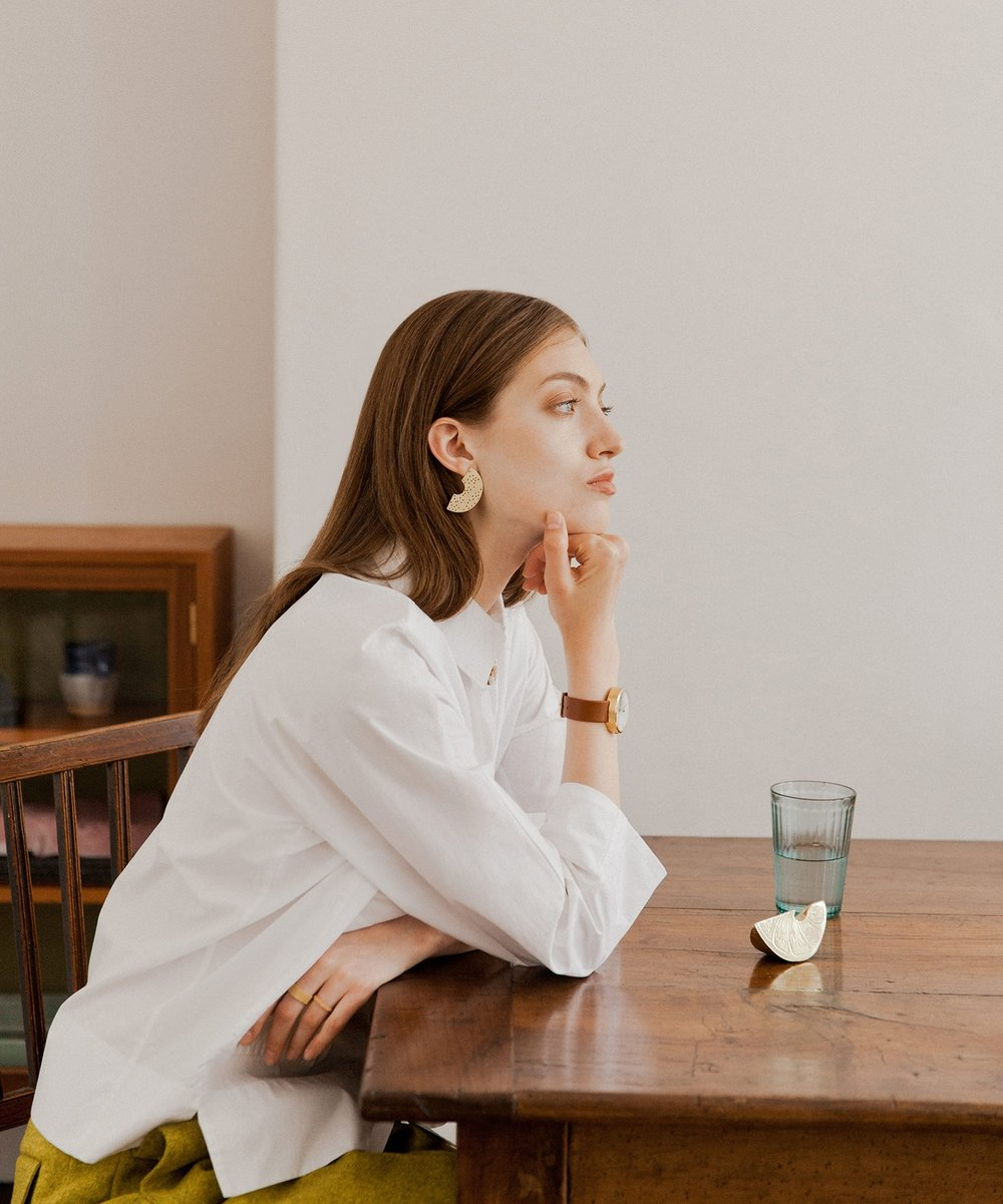 This page: Jan Machenhauer white shirt, £149, Found; Felted wool trouser, £89, COS; No.6 earrings, £40, Alice Bosc; Jacob Jensen yellow gold plate watch, £185, Quadri; Zag gold plate stainless steel mesh rings, £22 (wide) and £18 (thin), Quadri