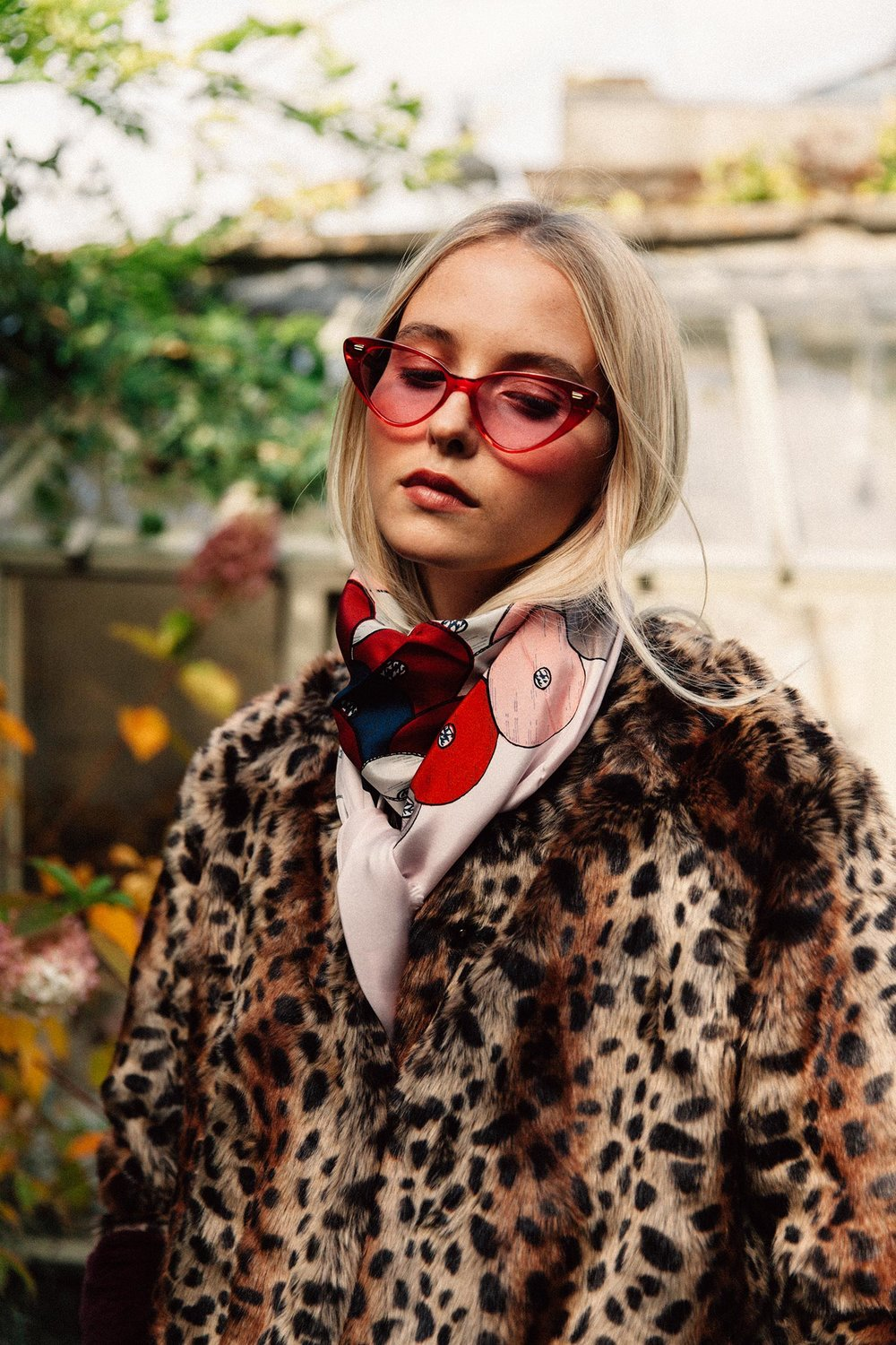 Leopard faux fur coat, £250, Lollys Laundry at  Rose & Lyons , Frome; Grand sequin print silk scarf, £135, Mii at  Found , Bath; Cat-eye sunglasses in red (model 1330-02), £300,  Cutler and Gross