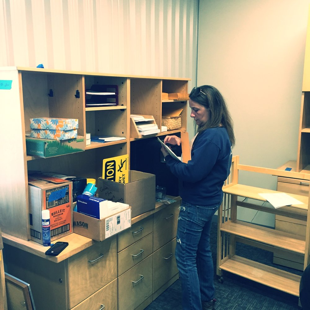 Michelle (Director of First Impressions) unpacking; getting ready for Monday!