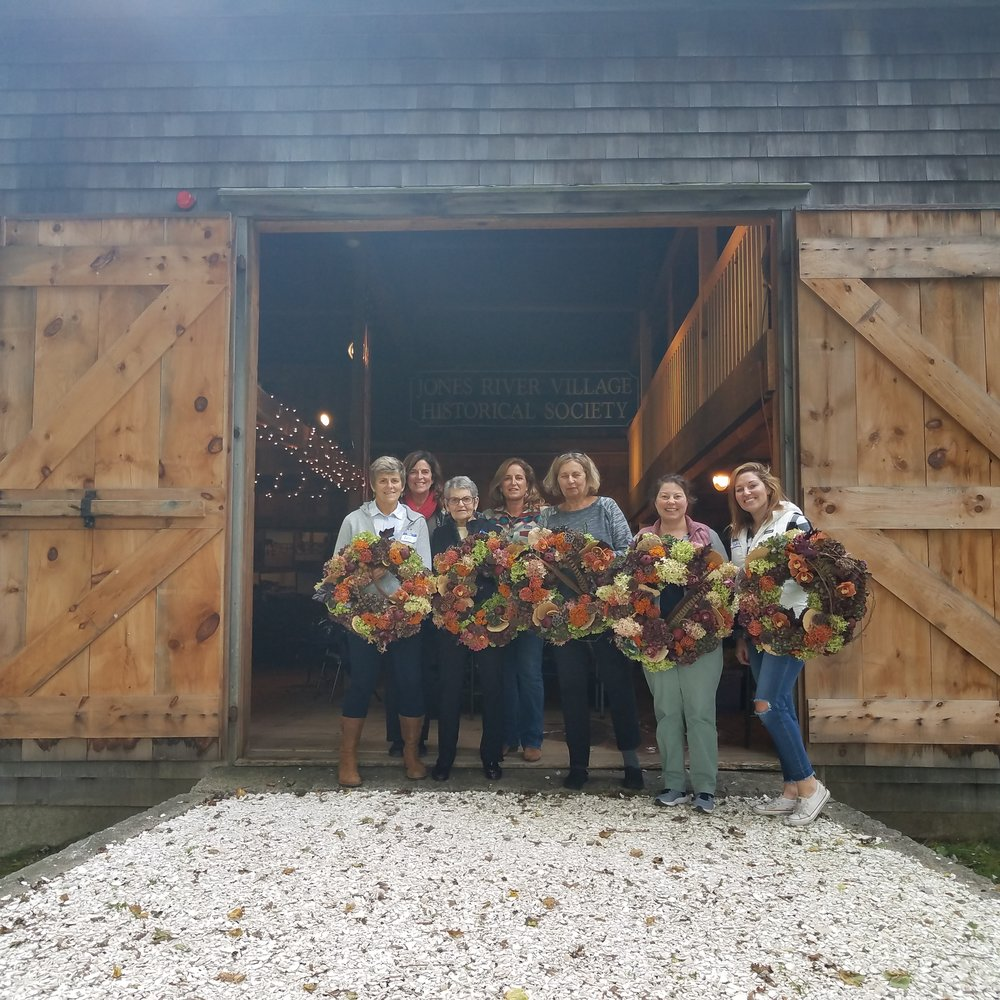 Fall Harvest WorkShops - We held our first workshop in the historical Threshing Barn at the Major John Bradford House in Kingston MA. The beautiful old homestead was a perfect backdrop for the fall harvest theme. Here the class learned about combining color, texture, scale and balance in wreath making. Fresh florals like Hydrangea, Yarrow, Protea and Orchids were used along with Fungi, Lotus pods, Promegranites and feathers to create this wreath and the outcome was outstanding!.