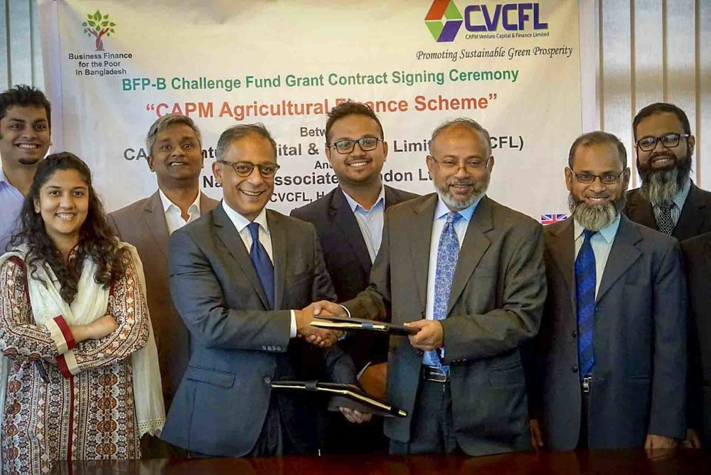 CAPM Venture Capital & Finance Limited (CVCFL) and Business Finance for the Poor in Bangladesh representatives together for a Challenge Fund signing ceremony in May 2018.