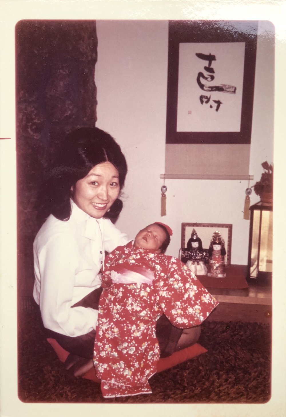 My mother and a sleeping, one-month-old me and the black-and gold shag carpet, before our  tokonoma  or altar with ceremonial dolls: Japanese Girls' Day, March 1973