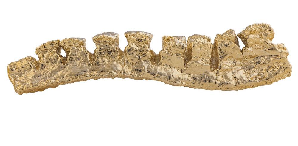 Antioquia chicharrón   Bronce con baño en oro,   5 x 15 cm. 2013
