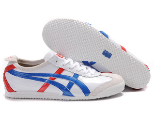 Classic Onitsuka Tiger sneakers, which were popular during the 60's and 70's.  They're going through a revival among the fashionistas as well as minimalist runners.  Notice the relatively flat sole and minimal design