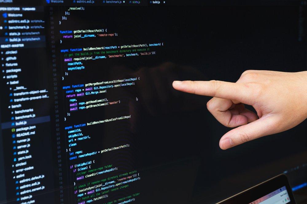 finger-pointing-at-javascript-code_4460x4460.jpg