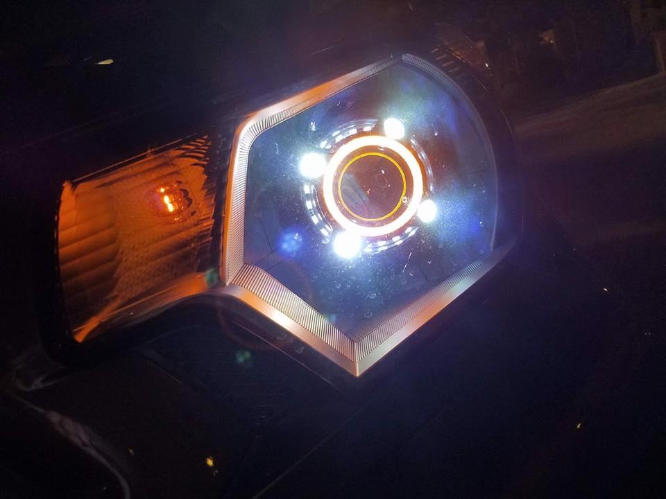 TACOma headlight w/ morimoto mini d2 projectors, porsche shrouds and switchback led halo.