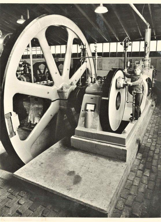 Philip Allen in 1976 with the Corliss Steam Engine at the New England Wireless and Steam Museum in East Greenwich, RI. He was chosen to start the engine because of his relationship to its inventor, and this day inspired Allen's lifelong affection for and career with machinery.