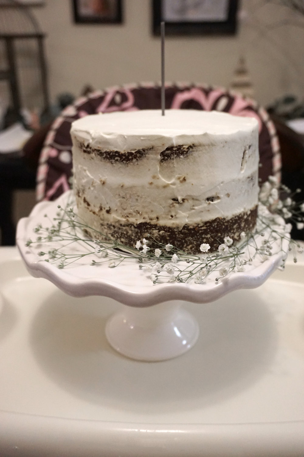 The cake almost slid off the stand when moving it onto the high chair (which is why the baby's breath is half off the stand) so what you're not seeing is a huge finger hole where I saved it ha!