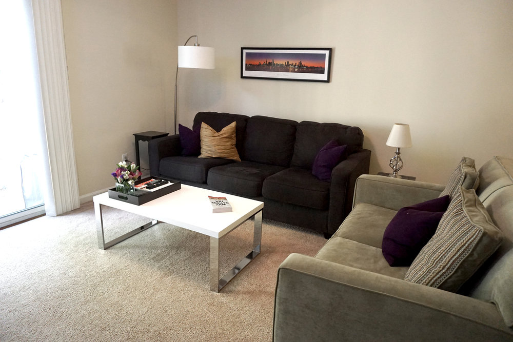 Before - The back of the green sofa was facing the entrance and it left guests unsure if they could sit.